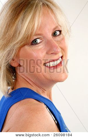 Head shot of smiling forty year old woman.