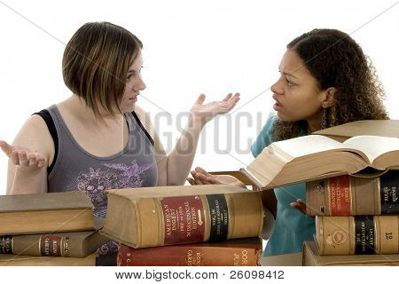Copyright on books has expired....  Study Session. Teen girls at table with old law books.