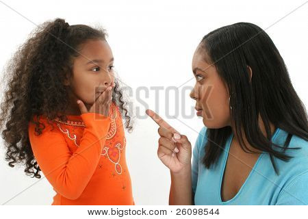 Adorable five year old African American Girl and mother having an argument