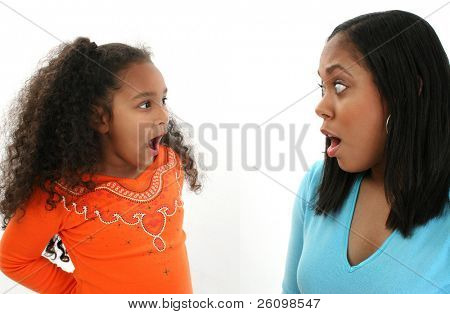 Adorable five year old girl in trouble with mom.
