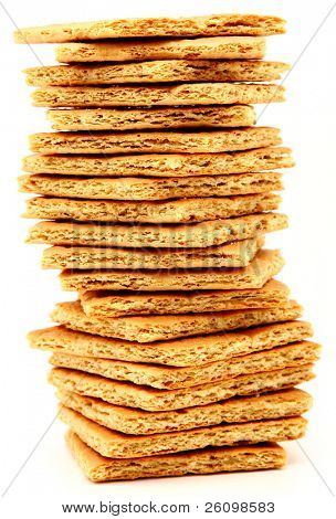 Stack of graham crackers over white.