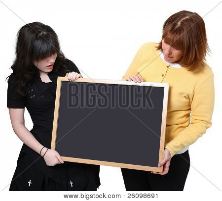Teacher and highschool student holding chalkboard over white.  Looking at chalkboard.