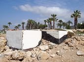 Abandoned White Painted Concrete Bunkers In Paphos Cyprus Dating From The Civil War Era With Rocks O poster