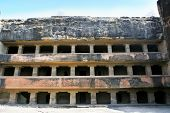 stock photo of ellora  - Facade of ancient Ellora rock carved Buddhist temple - JPG