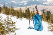 Backpack On The Background Of Snow-capped Mountains And Blue Sky. A Backpack On The Snow. Active Lif poster