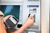 stock photo of automatic teller machine  - Cash withdrawal - JPG