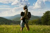Mother And Child In Summer Vacation. Mother And Child Hugging In Meadow In Vacation. Summer Vacation poster