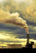 stock photo of noise pollution  - Thick smoke coming out of factory chimney - JPG