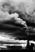 stock photo of noise pollution  - Polluting thick smoke coming out of factory chimney - JPG
