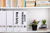 Work Safety And Safety Procedures Concept. Document Folders And Organizers, White Book Shelf poster