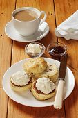 Devon Cream Tea, Scones, Jam, Cream And A Cup Of Tea, On An Old Pine Table. poster