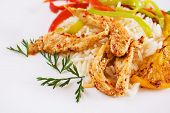 Spicy asian chicken meat with rice and vegetables poster