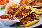 image of tacos  - Chili con carne burritos in corn taco shells - JPG