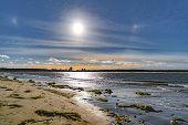 Rainbow Halo Around The Sun In Blue Evening Sky Above Baltic Sea Beach poster