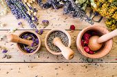 Preparation of medicinal herbs, dry flowers, ayurveda, wooden background, lavender poster