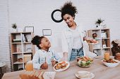 Mother And Daughter Time Together. Helping Little Girl With Food. Baby With Mother Eat. Young Girl A poster