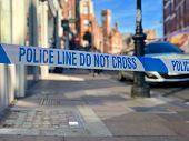 Police line do not cross crime scene perimeter cordon tape in a London street poster