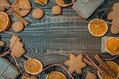 Christmas Top View Over A Brown Wooden Background With Gift Boxes Packed In A Craft Paper, Cookies,  poster