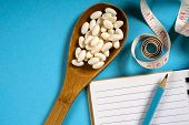 Sheet Of Diet Plan And Wooden Spoon With A Measuring Tape On A Blue Background, Diet, Healthy Lifest poster