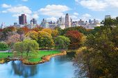 stock photo of new york skyline  - New York City Manhattan Central Park panorama in Autumn lake with skyscrapers and colorful trees with reflection - JPG
