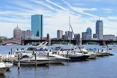 pic of prudential center  - Boston Charles River with urban city skyline skyscrapers and boats with blue skyr - JPG