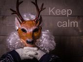 Human In A Deer  Mask With Crossed Fingers And Motto Keep Calm poster