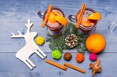 Mulled Wine Or Hot Beverage With Cinnamon, Orange Fruit And Fir Cone, Top View. Winter Beverage Conc poster