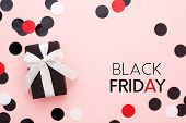 Black Friday Card. Black Gift Box With White Bow And Confetti On Pink Background. Top View, Copy Spa poster
