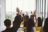 Raised Up Hands And Arms Of Large Group In Seminar Class Room At Conference poster