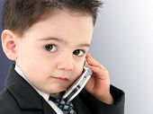 stock photo of baby-boy  -  Little man discussing important business on the cell phone - JPG