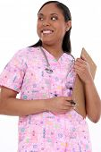 picture of disabled person  - Beautiful pediactric nurse in pink scrubs writing on clipboard - JPG
