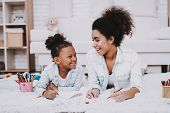Parent With Little Girl Draw Together. Baby And Young Mother Happy Time Together. Beautiful Girl Wit poster