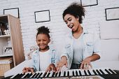 Mulatto And Young Girl Play Together. Smile And Happy Girl. Positive Time. Happiness Girl. Hobbies W poster