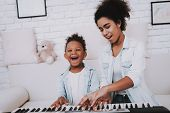 Babysitter Learn Piano With Young Girl. Education With Young Girl. People Play In The Piano. Hobbies poster