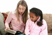 image of babysitter  - Adorable five year old African American Girl with babysitter reading - JPG
