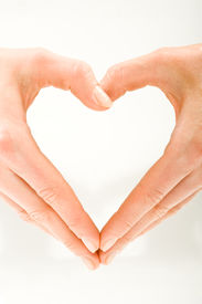 pic of heart shape  - The form of heart shaped by female hands on a white background - JPG
