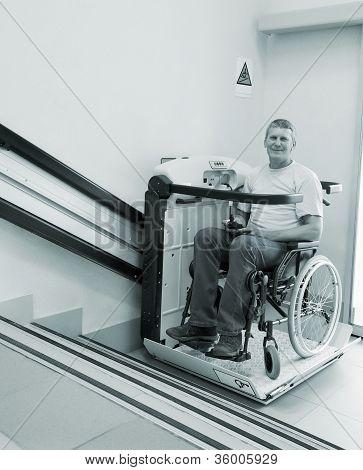 man in an invalid chair