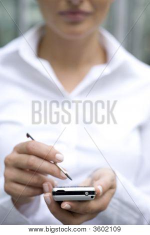 Woman Using Palmtop, Close-Up