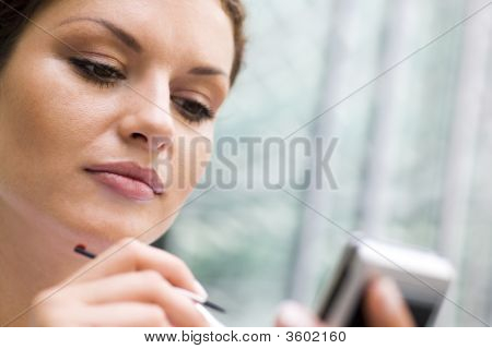 Young Woman Using Palmtop