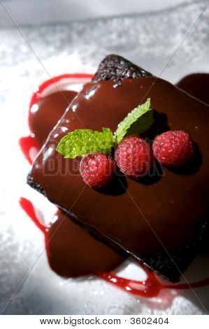 Decadent Chocolate Cake With Raspberries And Mint