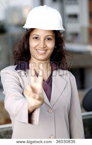 Female Architect Showing Victory Sign