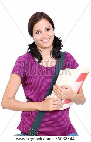 Young Female Student Holding Books