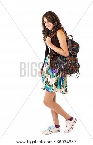 Teenage Girl In Flowered Dress With Backpack Over Shoulder