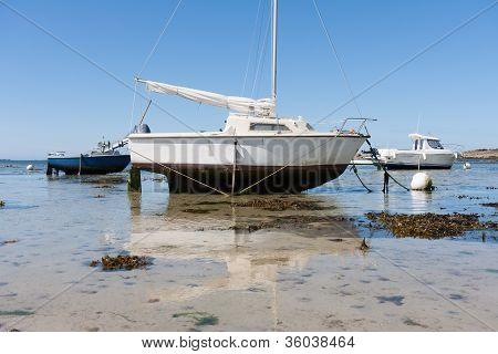 Small Boats At Ebb Tide In Brittany, France
