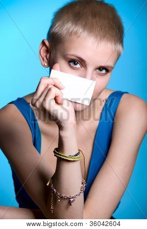 Portrait Of A Beautiful Girl Holding A Blank Notecard.