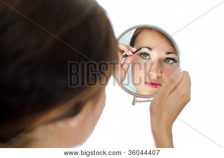 Young Attractive Woman Plucking Her Eyebrows With Tweezers. Isolated On White