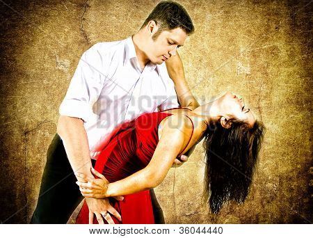 Cute Young Couple Dancing Latino