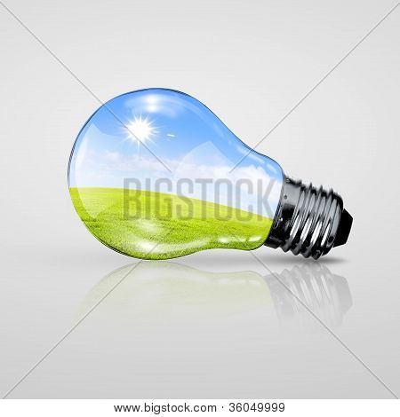 Electric light bulb and blue sky inside it
