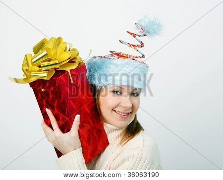 Portrait Of A Cheerful Young Woman In A Funny Christmas Hat