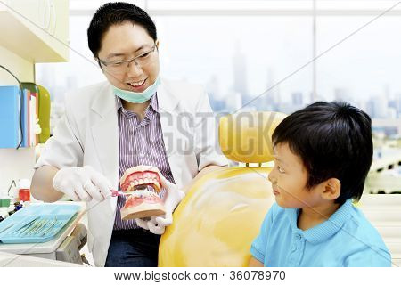 Asian Dentist Brushing Teeth Tutorial